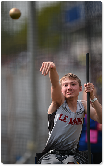 Boy throwing shot put.